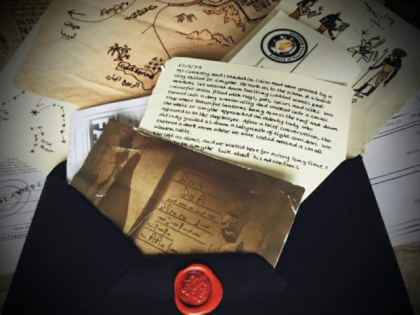 Unexpected letter in a black envelope contains an old photo, a diary page, a map, images of Egyptian pharaoh's and hyroglyphs