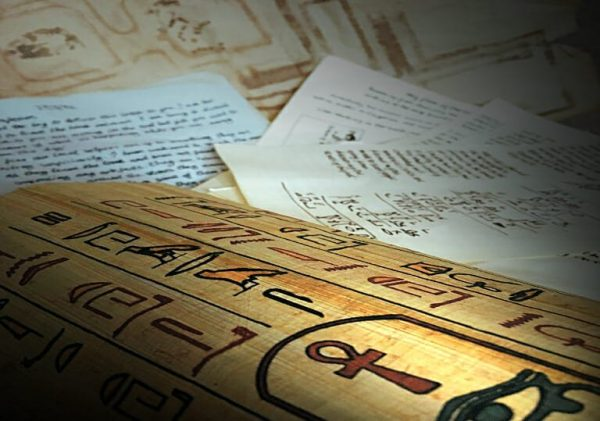 Documents, a papyrus scroll of hieroglyphs, a map, diary page, cyphers and codes