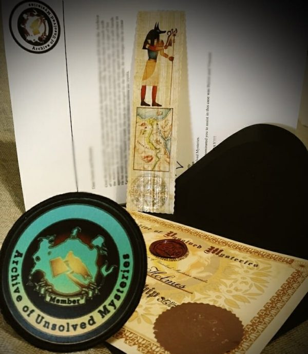 Pharaoh's Curse Children's Mystery 4th Mailing including a papyrus bookmark, a badge, a certificate and letter.